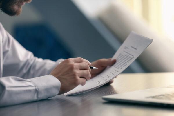 businessman inspecting documents