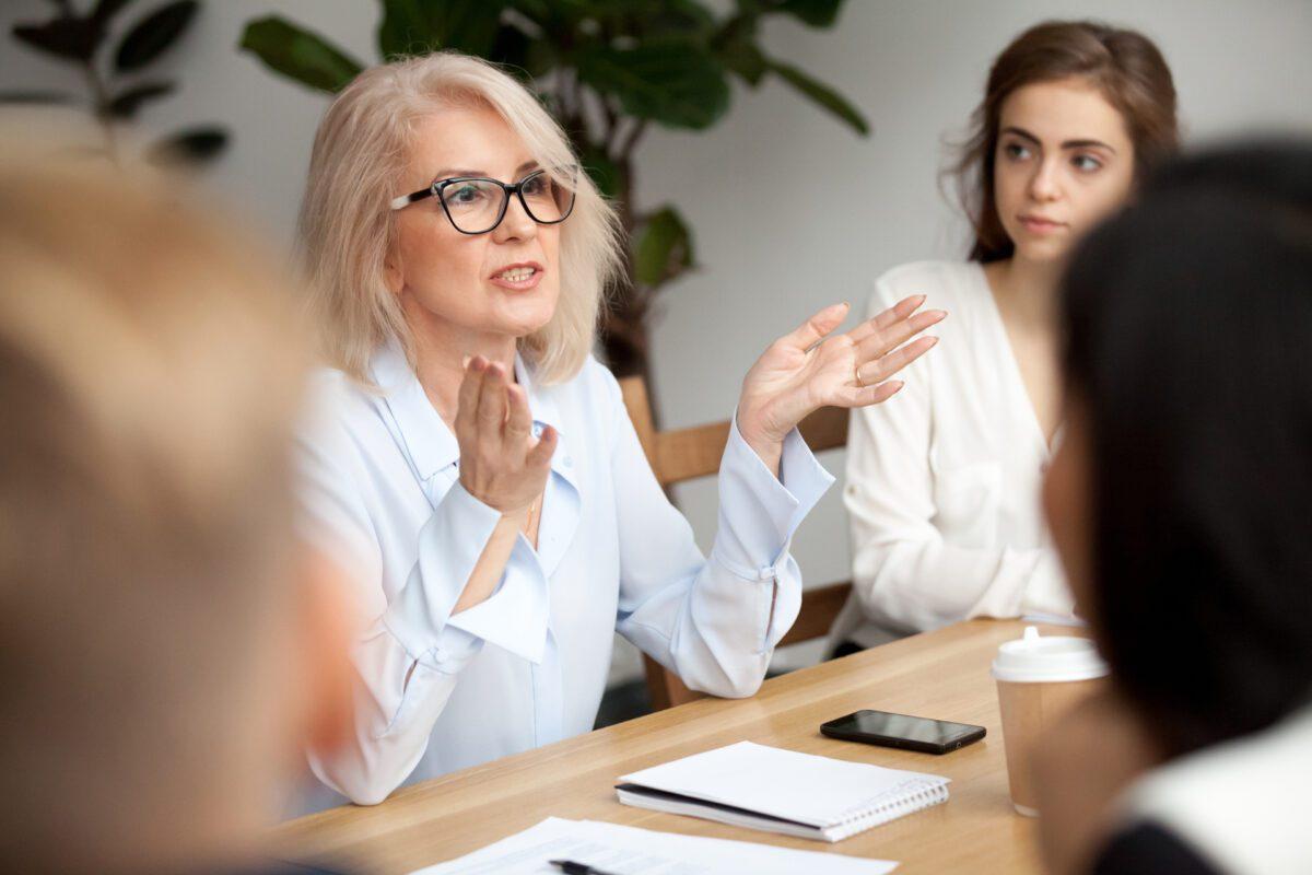 old businesswoman instructing